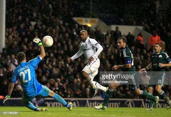 Jermain Defoe of Tottenham Hotspur scores their third goal past Orestis Karnezis of Panathinaikos during the UEFA Europa League Group J match between...