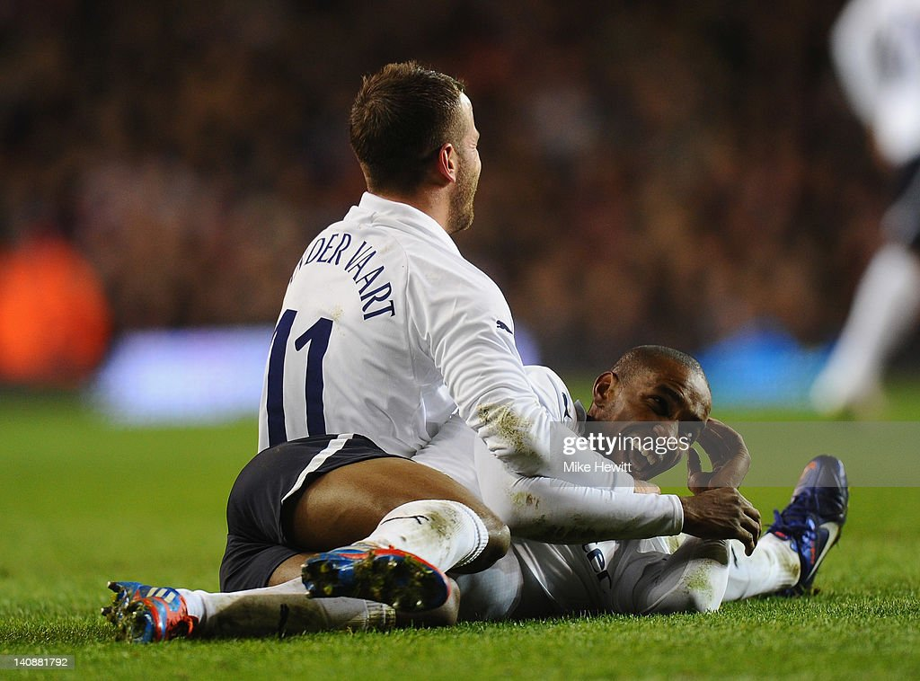Jermain Defoe of Tottenham laughs as he celebrates with team-mate Rafael Van der Vaart after scoring his team's third goal during the FA Cup Fifth Round Replay between Tottenham Hotspur and Stevenage at White Hart Lane on March 7, 2012 in London, England.