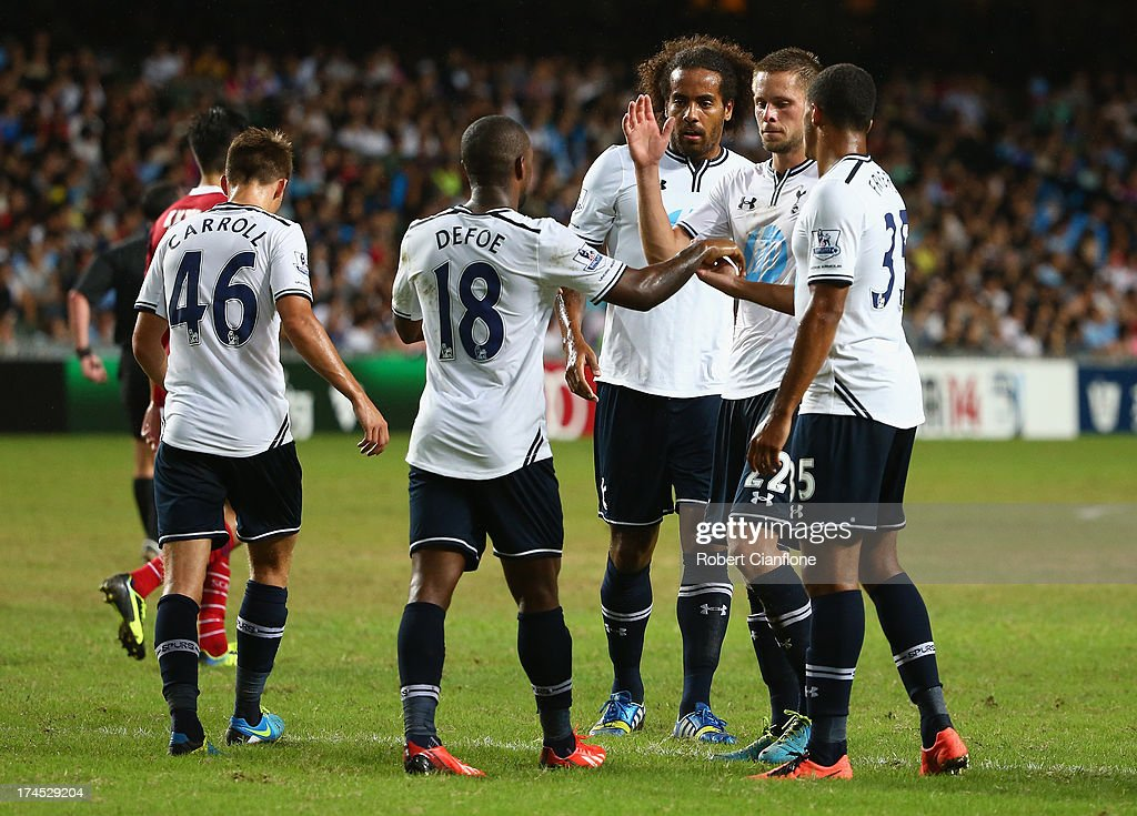 <a gi-track='captionPersonalityLinkClicked' href=/galleries/search?phrase=Jermain+Defoe&family=editorial&specificpeople=171106 ng-click='$event.stopPropagation()'>Jermain Defoe</a> of Tottenhan Hotspur celebrates his goal with team mates during the Third Place Play-Off match between Tottenham Hotspur and South China at Hong Kong Stadium on July 27, 2013 in So Kon Po, Hong Kong.