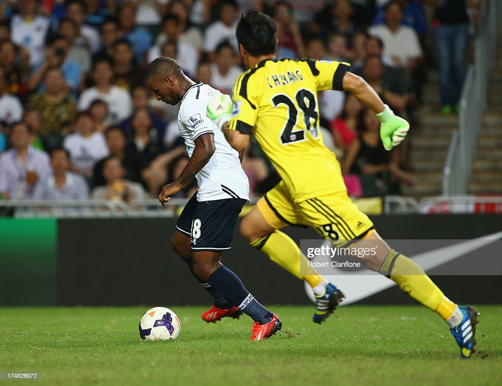<a gi-track='captionPersonalityLinkClicked' href=/galleries/search?phrase=Jermain+Defoe&family=editorial&specificpeople=171106 ng-click='$event.stopPropagation()'>Jermain Defoe</a> of Tottenhan Hotspur gets past goalkeeper Zhang Chunhui of South China to score during the Third Place Play-Off match between Tottenham Hotspur and South China at Hong Kong Stadium on July 27, 2013 in So Kon Po, Hong Kong.