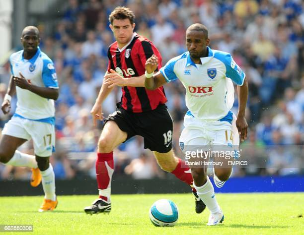 Jermain Defoe Portsmouth and Aaron Hughes Fulham battle for the ball