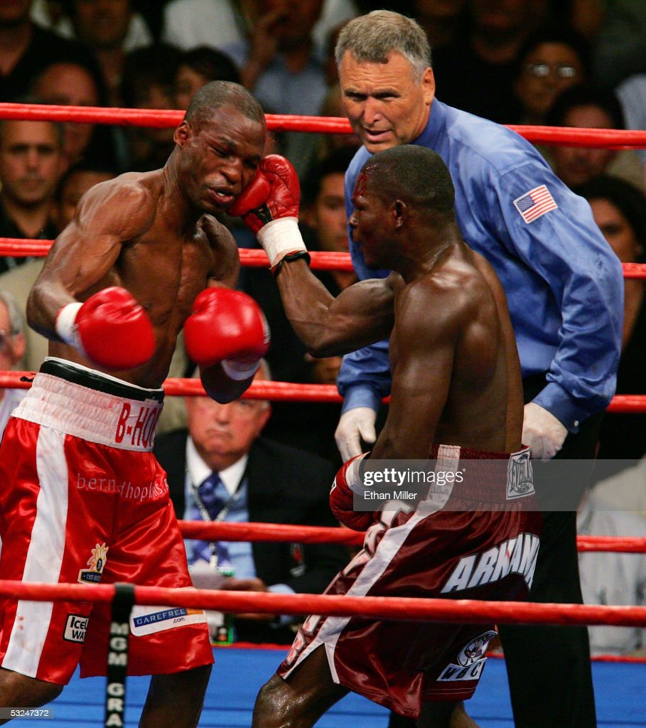 Jermain Taylor hits Bernard Hopkins as referee Jay Nady looks on during the undisputed middleweight championship fight at the MGM Grand Garden Arena...