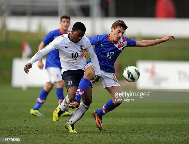 Jermaine Anderson of England and Nikola Vlasic of Croatia battle for the ball during the U18 International friendly match between England and Croatia...