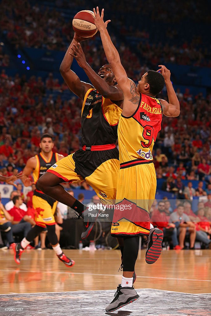 Jermaine Beal of the Wildcats drives the basket against Mustapha Farrakhan of the Tigers during the round 19 NBL match between the Perth Wildcats and the Melbourne Tigers at Perth Arena on February 21, 2014 in Perth, Australia.