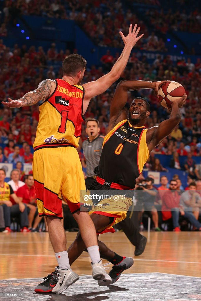 Jermaine Beal of the Wildcats drives to the basket against Nate Tomlinson of the Tigers during the round 19 NBL match between the Perth Wildcats and the Melbourne Tigers at Perth Arena on February 21, 2014 in Perth, Australia.