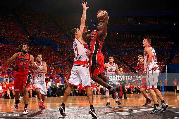 Jermaine Beal of the Wildcats drives to the basket against Oscar Foreman of the Hawks during game one of the NBL Semi Final series between the Perth...