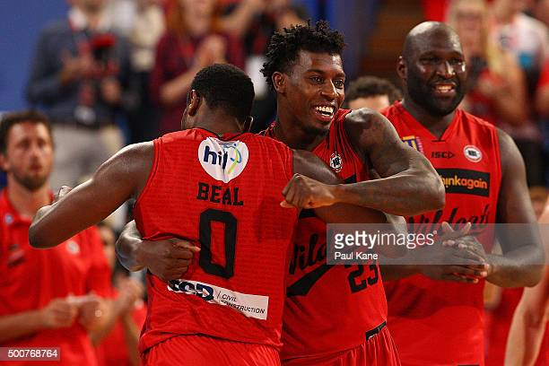 Jermaine Beal of the Wildcats gets a hug from Casey Prather after being substituted during the round 10 NBL match between the Perth Wildcats and...