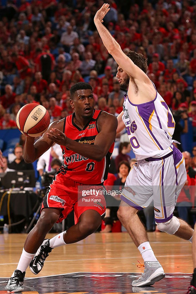 Jermaine Beal of the Wildcats passes the ball off against Jarrad Weeks of the Kings during the round two NBL match between the Perth Wildcats and the Sydney Kings at Perth Arena in October 18, 2013 in Perth, Australia.