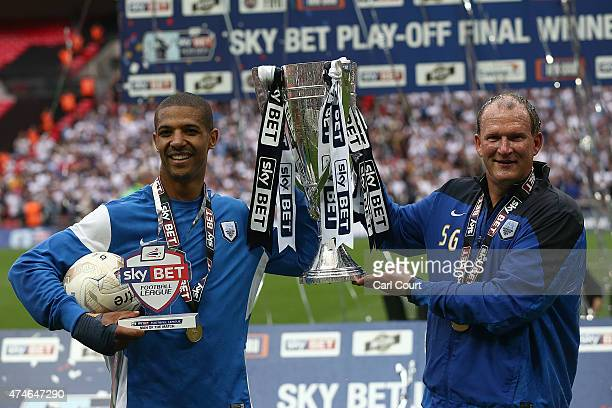 Jermaine Beckford and manager Simon Grayson of Preston North End celebrates after winning the League One playoff final between Preston North End and...