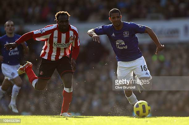 Jermaine Beckford of Everton attempts to move forward with the ball against John Mensah of Sunderland during the Barclays Premier League match...