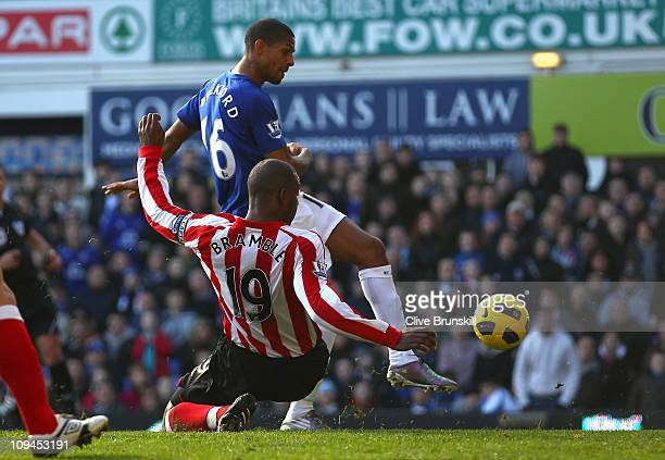 Jermaine Beckford of Everton scores his second goal against John Mensah of Sunderland during the Barclays Premier League match between Everton and...