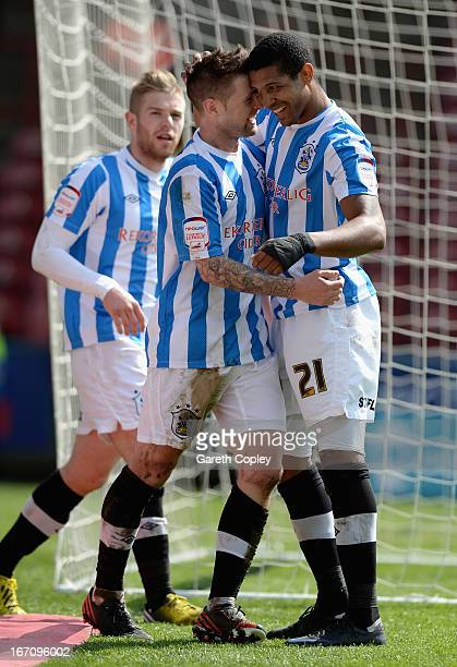 Jermaine Beckford of Huddersfield celebrates with Peter Clarke after scoring the opening goal during the npower Championship match between...