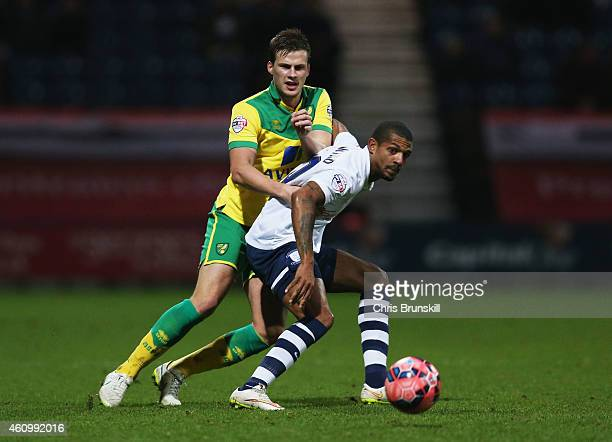 Jermaine Beckford of Preston North End holds off Ryan Bennett of Norwich City during the FA Cup Third Round match between Preston North End and...