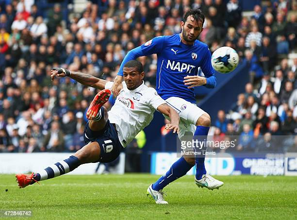 Jermaine Beckford of Preston North End holds off Sam Hird of Chesterfield to score their first goal during the Sky Bet League One Playoff SemiFinal...