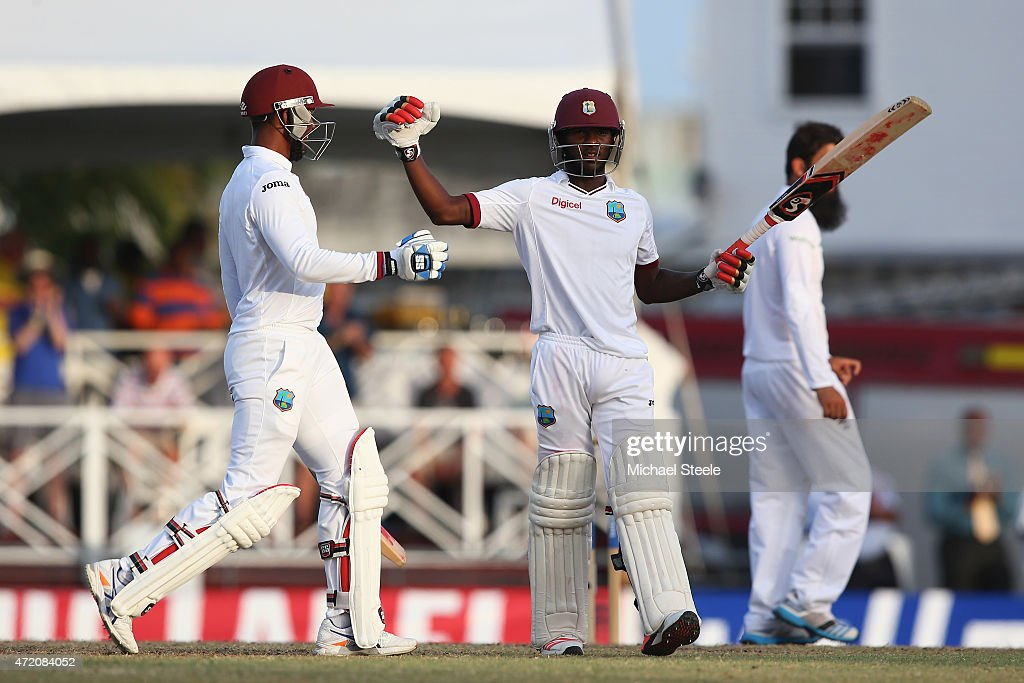 Jermaine Blackwood (R) and Denesh Ramdin (L) of West Indies celebrate victory and drawing the series 1-1 during day three of the 3rd Test match between West Indies and England at Kensington Oval on May 3, 2015 in Bridgetown, Barbados.