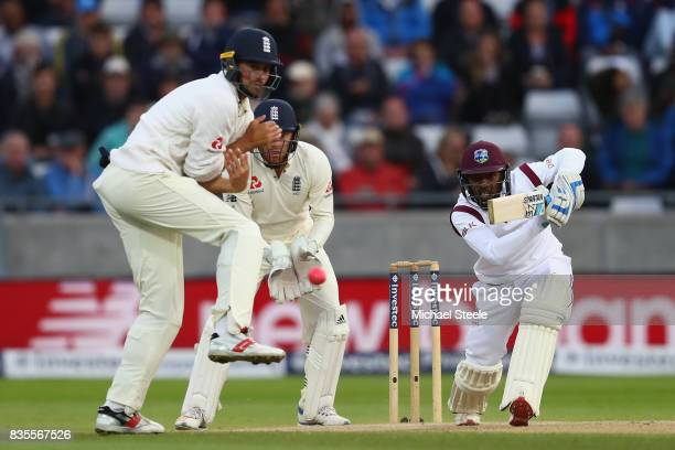 Jermaine Blackwood of West Indies drives off the bowling of Moeen Ali as Mark Stoneman turns his back during day three of the 1st Investec Test match...
