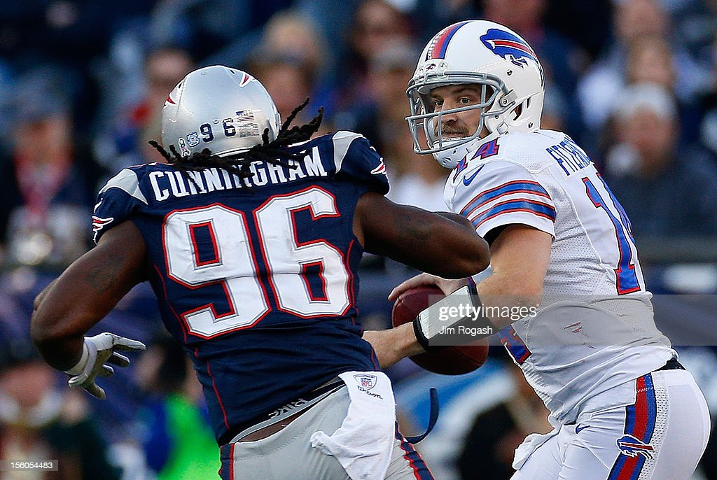 Jermaine Cunningham #96 of the New England Patriots chases <a gi-track='captionPersonalityLinkClicked' href=/galleries/search?phrase=Ryan+Fitzpatrick&family=editorial&specificpeople=622098 ng-click='$event.stopPropagation()'>Ryan Fitzpatrick</a> #14 of the Buffalo Bills in the second half at Gillette Stadium on November 11, 2012 in Foxboro, Massachusetts.