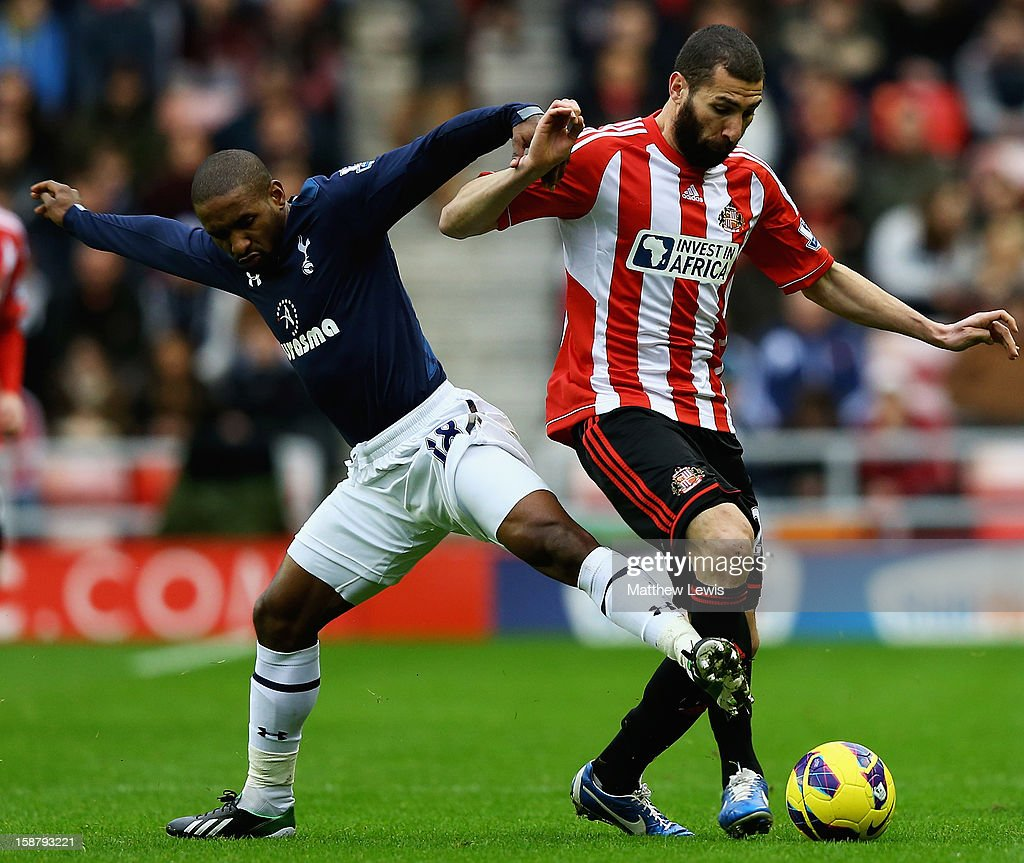 Jermaine Defo of Tottenham is tackled by <a gi-track='captionPersonalityLinkClicked' href=/galleries/search?phrase=Carlos+Cuellar&family=editorial&specificpeople=2116627 ng-click='$event.stopPropagation()'>Carlos Cuellar</a> of Sunderland during the Barclays Premier League match between Sunderland and Tottenham Hotspur at Stadium of Light on December 29, 2012 in Sunderland, England.