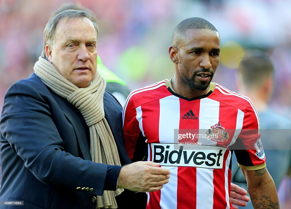 Jermaine Defoe is congratulated by Sunderland manager Dick Advocaat during the Barclays Premier League match between Sunderland AFC and Newcastle United at the Stadium of Light on April 05, 2015 in Sunderland, England.