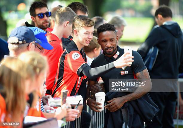 Jermaine Defoe of Bournemouth interacts with supporters prioro to the Premier League match between AFC Bournemouth and Manchester City at Vitality...