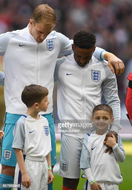 Jermaine Defoe of England and England mascot Bradley Lowery line up prior to the FIFA 2018 World Cup Qualifier between England and Lithuania at...
