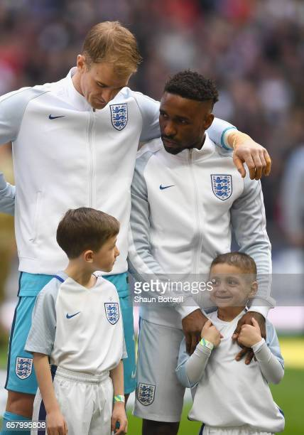 Jermaine Defoe of England and England mascot Bradley Lowery line up alongside Joe Hart prior to the FIFA 2018 World Cup Qualifier between England and...