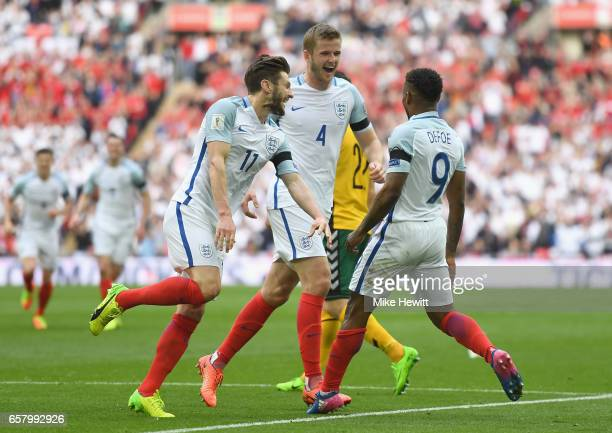 Jermaine Defoe of England celebrates with Adam Lallana and Eric Dier after scoring his sides first goal during the FIFA 2018 World Cup Qualifier...