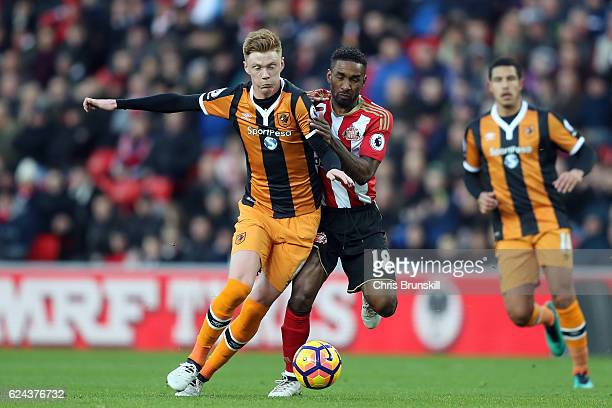 Jermaine Defoe of Sunderland in action with Sam Clucas of Hull City during the Barclays Premier League match between Sunderland and Hull City at the...