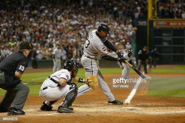 Jermaine Dye of the Chicago White Sox hits a game winning single to score Willie Harris in the eighth inning during Game 4 of the 2005 World Series...