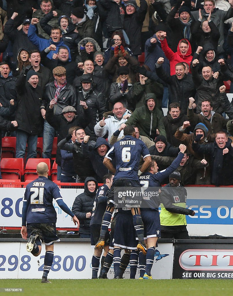 Jermaine Easter of Millwall celebrates scoring the first goal with his teammates during the npower Championship match between Charlton Athletic and Millwall at The Valley on March 16, 2013 in London, England.