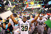 Jermaine Edmondson of the Michigan State Spartans celebrates a 4241 win against the Baylor Bears during the Goodyear Cotton Bowl Classic at ATT...