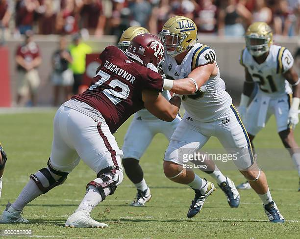 Jermaine Eluemunor of the Texas AM Aggies blocks Rick Wade of the UCLA Bruins on September 3 2016 in College Station Texas