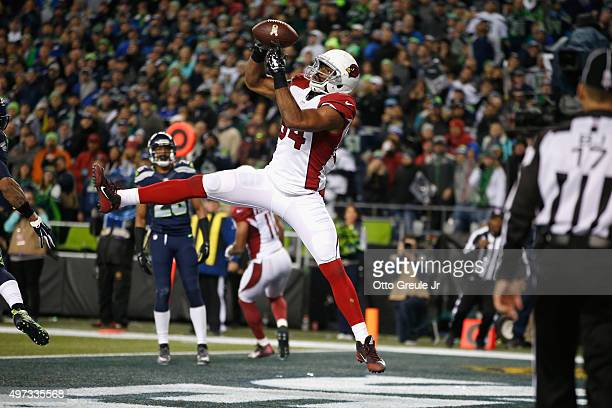 Jermaine Gresham of the Arizona Cardinals scores a touchdown during the fourth quarter against the Seattle Seahawks at CenturyLink Field on November...