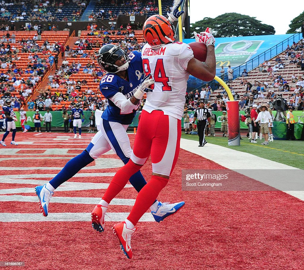 Jermaine Gresham #84 of the Cincinnati Bengals and the AFC goes up for a pass against Thomas DeCoud #28 of the National Football Conference team during the 2013 Pro Bowl at Aloha Stadium on January 27, 2013 in Honolulu, Hawaii