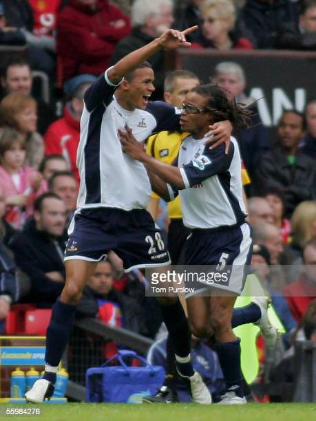 Jermaine Jenas of Tottenham Hotspur celebrates scoring the equalising goal with Edgar Davids during the Barclays Premiership match between Manchester...