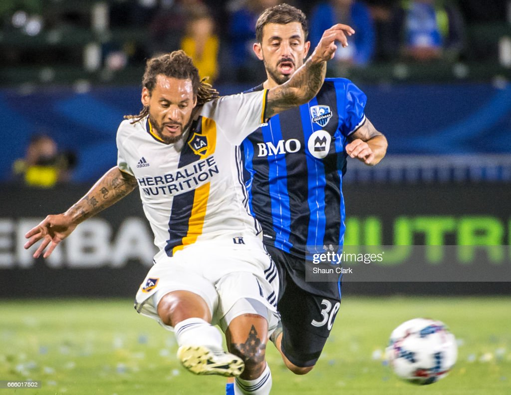 Jermaine Jones #13 of Los Angeles Galaxy crosses the ball as Hernan Bernardello #30 of Montreal Impact defends during Los Angeles Galaxy's MLS match against Montreal Impact at the StubHub Center on April 7, 2017 in Carson, California. The LA Galaxy won the match 2-0