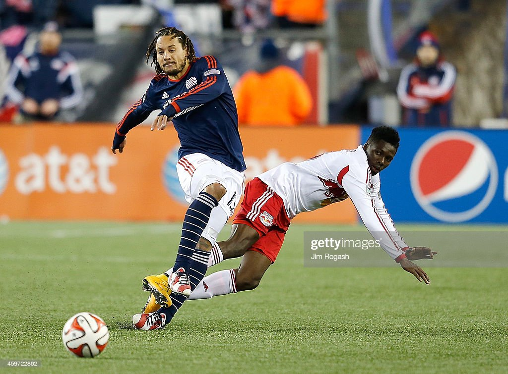 <a gi-track='captionPersonalityLinkClicked' href=/galleries/search?phrase=Jermaine+Jones+-+Futebolista&family=editorial&specificpeople=12906336 ng-click='$event.stopPropagation()'>Jermaine Jones</a> #13 of New England Revolution defends against <a gi-track='captionPersonalityLinkClicked' href=/galleries/search?phrase=Ambroise+Oyongo&family=editorial&specificpeople=8006933 ng-click='$event.stopPropagation()'>Ambroise Oyongo</a> #3 of New York Red Bulls in the second half during Leg 2 of the MLS Eastern Conference game at Gillette Stadium on November 29, 2014 in Foxboro, Massachusetts.