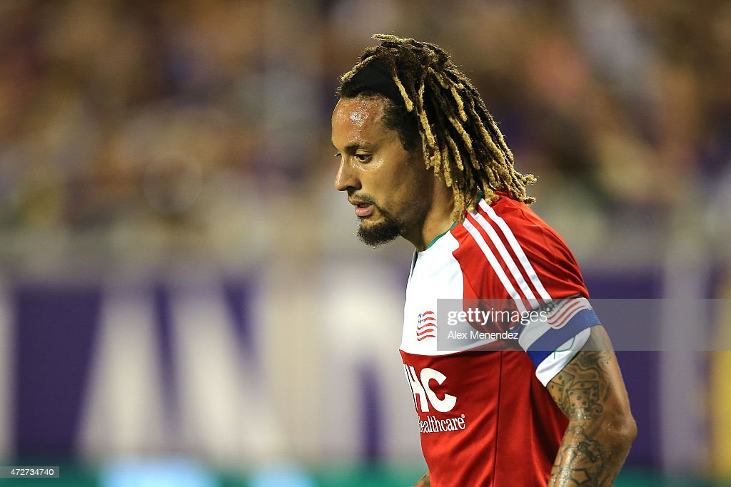 <a gi-track='captionPersonalityLinkClicked' href=/galleries/search?phrase=Jermaine+Jones+-+Futebolista&family=editorial&specificpeople=12906336 ng-click='$event.stopPropagation()'>Jermaine Jones</a> #13 of New England Revolution looks at an injured player on the ground during an MLS soccer match between the New England Revolution and the Orlando City SC at the Orlando Citrus Bowl on May 8, 2015 in Orlando, Florida. The game ended in a 2-2 tie.