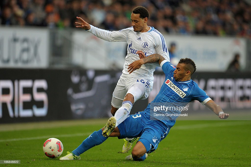 <a gi-track='captionPersonalityLinkClicked' href=/galleries/search?phrase=Jermaine+Jones+-+Fotbollsspelare&family=editorial&specificpeople=12906336 ng-click='$event.stopPropagation()'>Jermaine Jones</a> of Schalke and Daniel Williams of Hoffenheim battle for the ball during the Bundesliga match between TSG 1899 Hoffenheim and FC Schalke 04 at Rhein-Neckar-Arena on November 3, 2012 in Sinsheim, Germany.