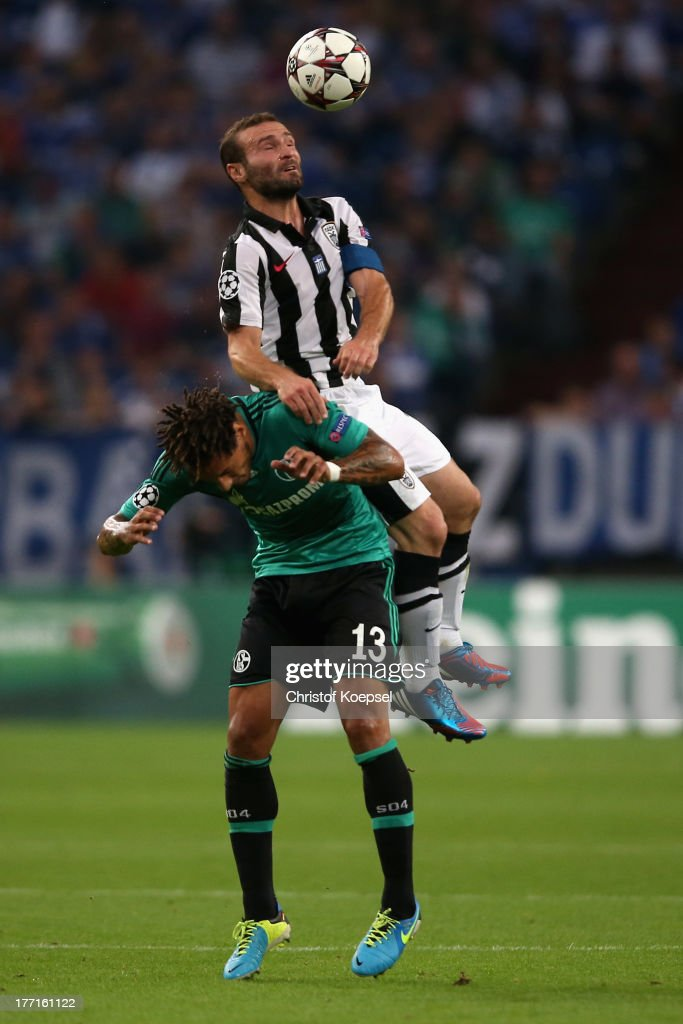<a gi-track='captionPersonalityLinkClicked' href=/galleries/search?phrase=Jermaine+Jones+-+Soccer+Player&family=editorial&specificpeople=12906336 ng-click='$event.stopPropagation()'>Jermaine Jones</a> of Schalke and Dimitris Salpingidis of Saloniki go up for a header during the UEFA Champions League Play-off first leg match between FC Schalke 04 and PAOK Saloniki at Veltins-Arena on August, 21, 2013 in Gelsenkirchen, Germany.