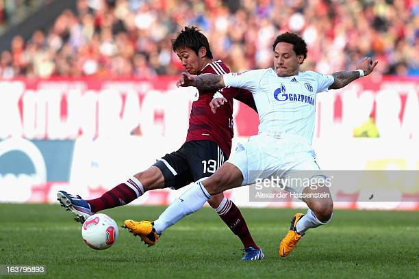 Jermaine Jones of Schalke battles for the ball Hiroshi Kiyotake of Nuernberg during the Bundesliga match between 1 FC Nuernberg and FC Schalke 04 at...