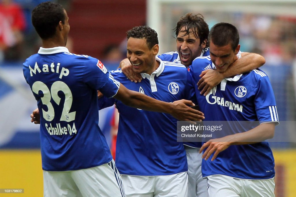 <a gi-track='captionPersonalityLinkClicked' href=/galleries/search?phrase=Jermaine+Jones+-+Soccer+Player&family=editorial&specificpeople=12906336 ng-click='$event.stopPropagation()'>Jermaine Jones</a> of Schalke (2nd L) celebrates the first goal with <a gi-track='captionPersonalityLinkClicked' href=/galleries/search?phrase=Joel+Matip&family=editorial&specificpeople=4462851 ng-click='$event.stopPropagation()'>Joel Matip</a> (L), <a gi-track='captionPersonalityLinkClicked' href=/galleries/search?phrase=Raul+Gonzalez+-+Soccer+Player&family=editorial&specificpeople=213309 ng-click='$event.stopPropagation()'>Raul Gonzalez</a> (2nd R) and <a gi-track='captionPersonalityLinkClicked' href=/galleries/search?phrase=Christoph+Moritz&family=editorial&specificpeople=6144711 ng-click='$event.stopPropagation()'>Christoph Moritz</a> (R) during the LIGA total! Cup 2010 match between FC Schalke 04 and Hamburger SV at the Veltins Arena on July 31, 2010 in Gelsenkirchen, Germany.