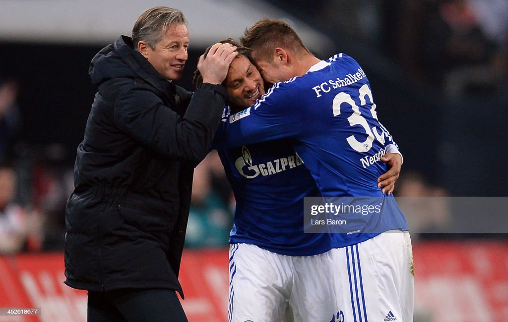 <a gi-track='captionPersonalityLinkClicked' href=/galleries/search?phrase=Jermaine+Jones+-+Futebolista&family=editorial&specificpeople=12906336 ng-click='$event.stopPropagation()'>Jermaine Jones</a> of Schalke celebrates with head coach <a gi-track='captionPersonalityLinkClicked' href=/galleries/search?phrase=Jens+Keller&family=editorial&specificpeople=2382918 ng-click='$event.stopPropagation()'>Jens Keller</a> and team mate Roman Neustaedter after scoring his teams third goal during the Bundesliga match between FC Schalke 04 and VfB Stuttgart at Veltins-Arena on November 30, 2013 in Gelsenkirchen, Germany.