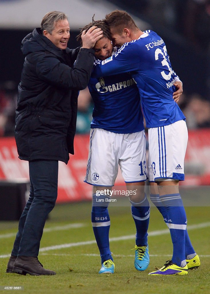 Jermaine Jones of Schalke celebrates with head coach Jens Keller and team mate Roman Neustaedter after scoring his teams third goal during the Bundesliga match between FC Schalke 04 and VfB Stuttgart at Veltins-Arena on November 30, 2013 in Gelsenkirchen, Germany.