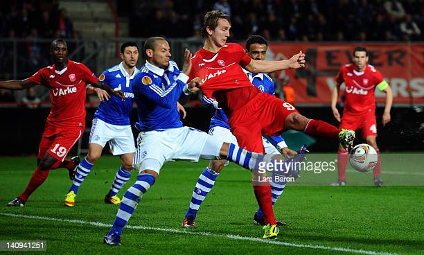 Jermaine Jones of Schalke challenges Luuk de Jong of Twente during the UEFA Europa League Round of 16 first leg match between FC Twente and FC...