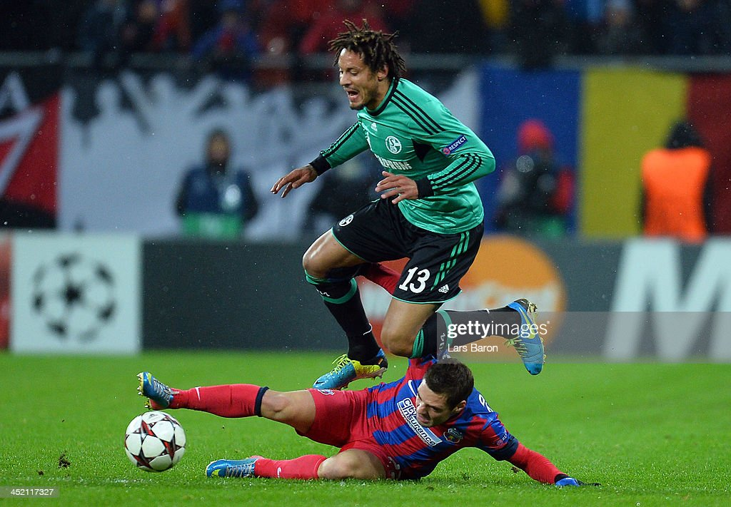 Jermaine Jones of Schalke is challenged by Adrian Popa of Steaua during the UEFA Champions League Group E match between FC Steaua Bucuristi and FC Schalke 04 at National Stadium on November 26, 2013 in Bucharest, Romania.