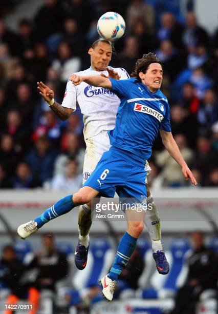 Jermaine Jones of Schalke jumps for a header with Sebastian Rudy of Hoffenheim during the Bundesliga match between 1899 Hoffenheim and FC Schalke 04...