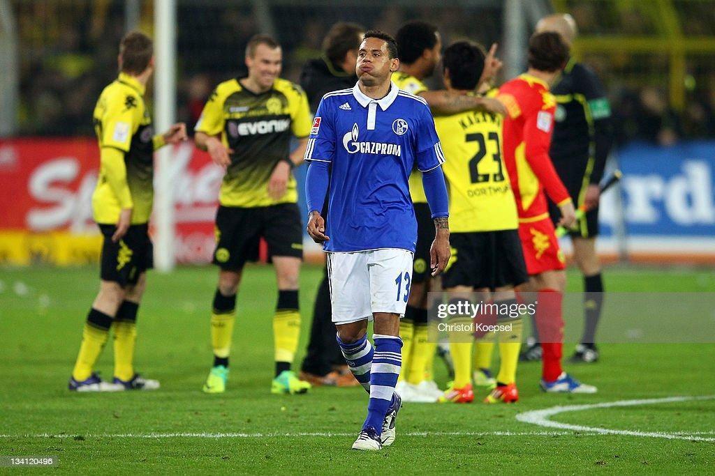 Jermaine Jones of Schalke looks dejected after losing 0-2 the Bundesliga match between Borussia Dortmund and FC Schalke 04 at Signal Iduna Park on November 26, 2011 in Dortmund, Germany.