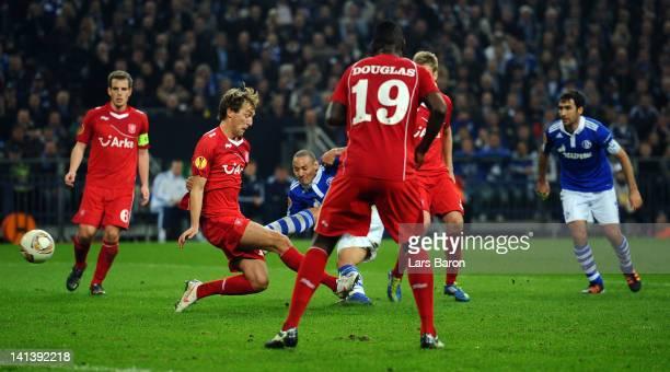 Jermaine Jones of Schalke scores his teams third goal during the UEFA Europa League Round of 16 second leg match between FC Schalke 04 and FC Twente...