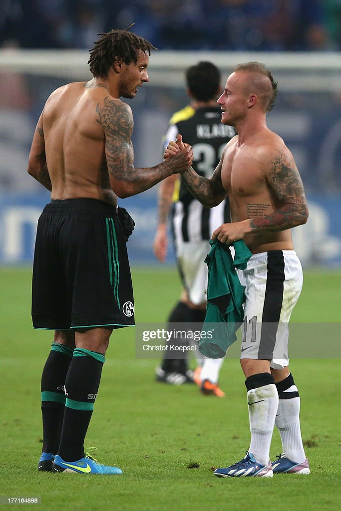 <a gi-track='captionPersonalityLinkClicked' href=/galleries/search?phrase=Jermaine+Jones+-+Soccer+Player&family=editorial&specificpeople=12906336 ng-click='$event.stopPropagation()'>Jermaine Jones</a> of Schalke shake hand with scorer <a gi-track='captionPersonalityLinkClicked' href=/galleries/search?phrase=Miroslav+Stoch&family=editorial&specificpeople=5446681 ng-click='$event.stopPropagation()'>Miroslav Stoch</a> of Saloniki after the UEFA Champions League Play-off first leg match between FC Schalke 04 and PAOK Saloniki at Veltins-Arena on August, 21, 2013 in Gelsenkirchen, Germany. The match between Schalke and Saloniki ended 1-1.
